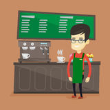 Barista standing near coffee machine. Royalty Free Stock Photos