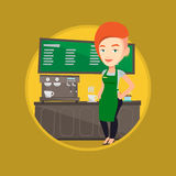 Barista standing near coffee machine. Royalty Free Stock Images