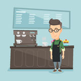Barista standing near coffee machine. Royalty Free Stock Image