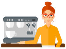 Barista standing near coffee maker Royalty Free Stock Images