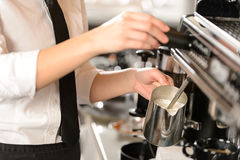 Barista steaming milk for hot cappuccino Royalty Free Stock Photos