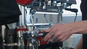 Barista take coffee grind in group, prepare to brewing espresso shot