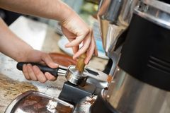 Barista Tamping Coffee Stock Images