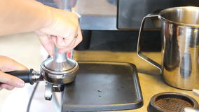 Barista Tamping Fresh Ground Coffee stock footage