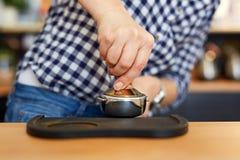 Barista tamping freshly ground coffee Stock Photos
