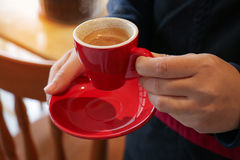 Barista taste with Red cup espresso. Vintage tone. Selective Focus Royalty Free Stock Image
