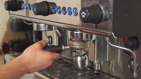 The barista is making coffee in the coffee machine royalty free stock images