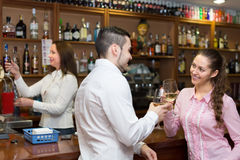 Barista and two clients at counter Royalty Free Stock Photos