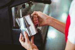 A barista using the coffee machine Stock Image