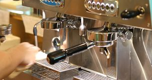 Barista using coffee machine equipment in cafe. Restaurant stock video