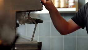 Barista using coffee machine. In high quality format stock footage