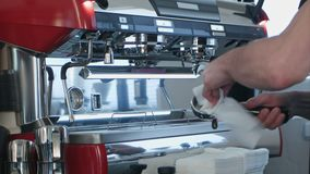 Barista using coffee machine preparing fresh coffee. Close up. Professional shot in 4K resolution. 091. You can use it e.g. in your commercial video, business stock video footage