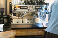 Barista using a coffee maker royalty free stock photo