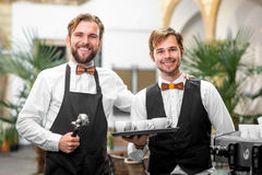 Barista and waiter portrait Royalty Free Stock Photos