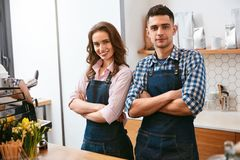 Barista And Waitress Working In Cafe Stock Photos