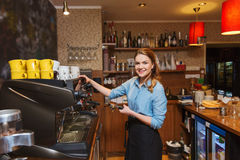 Barista woman making coffee by machine at cafe Royalty Free Stock Images