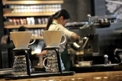 Barista women in the coffee shop