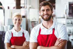 2 baristas усмехаясь на камере Стоковая Фотография RF