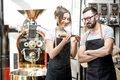 Baristas checking the quality of coffee Stock Image