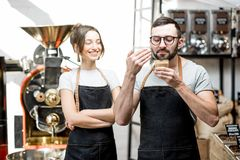 Baristas checking the quality of coffee Royalty Free Stock Photography