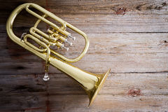 Baritone Horn on a Wooden Floor with Copy Space Royalty Free Stock Photo