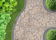 Bark chaff in the garden. Garden detail in aerial view with chaff path Royalty Free Stock Photos