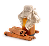 Bark of cinnamon and pharmaceutical bottle. Stock Image
