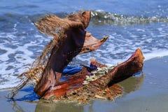 A bark full of stones on the beach Stock Photos