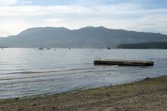 Barka przy zmierzchem przy Kitsilano plażą Obraz Royalty Free