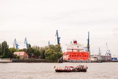 Launch boat on Elbe River cruising shipyard Blohm und Voss . Hamburg, Germany - July 07, 2014: Launch boat on Elbe River cruising shipyard Blohm und Voss with stock photography