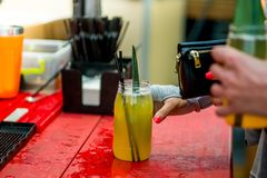 Barkeeper preparing a cocktail. In a plastic glass outdoors. catering stock images