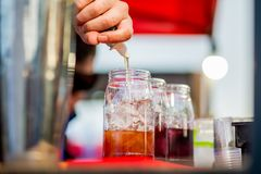 Barkeeper preparing a cocktail. In a plastic glass outdoors. catering stock image