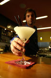Barkeeper serves Margarita. The bartender serves a refreshing Margharita Stock Photo
