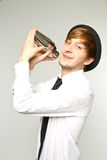 Barkeeper shaking cocktails. Young barkeeper shaking fresh cocktails royalty free stock images