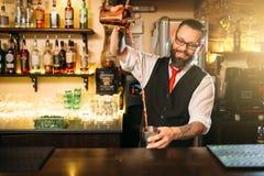 Barkeeper show behind restaurant bar counter. Handsome alcohol beverage preparation stock image
