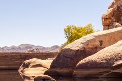 Barker Dam in a nice sunny day. Barker Dam with low water picture taken at Joshua Tree National Park USA royalty free stock images