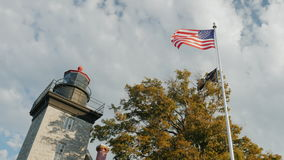 Barker, NY, USA - Barker Light House at Ontario Lake and USA flag. Barker Light House at Ontario Lake and USA flag stock video