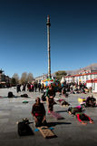 Barkhor Square and its Devotees praying Lhasa Tibet Royalty Free Stock Photo