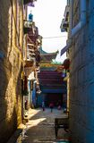 Barkhor Street and folk house Stock Image