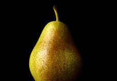 Barlett pear against black Stock Photos