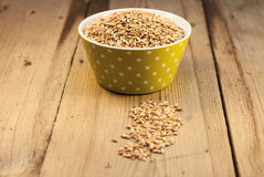 Barley in  bowl on wooden background Stock Photos