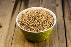 Barley in a bowl on wooden background Royalty Free Stock Photography