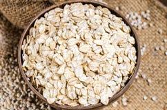 barley flakes and pearl barley in sack bag Stock Photos