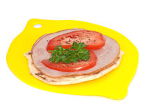 Barley flatbread topped with cheese, ham, tomato Royalty Free Stock Photography