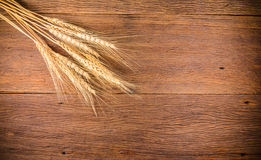 Barley grain on wooden table Stock Photo