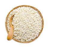Barley grit. In weave basket on white background Stock Photo