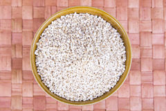 Barley groats in a brown bowl. Top view Stock Images