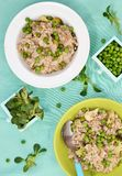 Barley groats risotto with green peas Stock Images