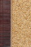Barley lying on dark bamboo mat, for menu Royalty Free Stock Image