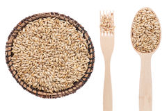 Barley in a plate, fork and spoon Stock Photos